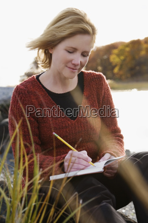 mature woman sitting on the beach