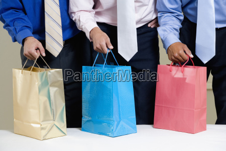 mid section view of three businessmen