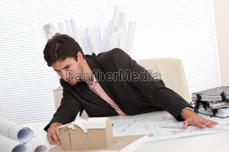 successful architect working at office