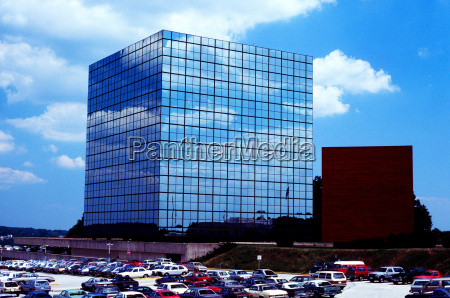 blue cross building with sky reflections