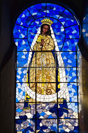 virgin mary painting on a stained