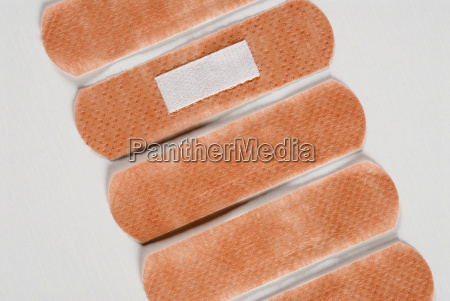 close up of five adhesive bandages