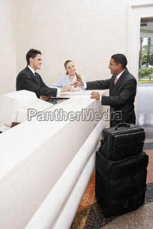 businessman and two receptionists at a