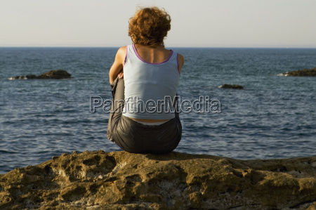 rear view of a woman sitting