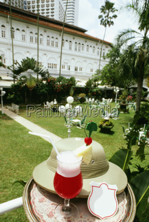 singapore sling with a hat on