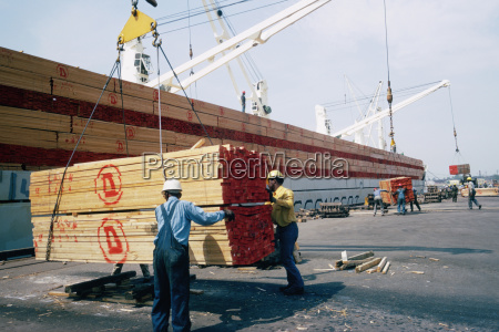 workers unloading a shipment of treated