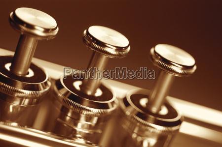 extreme close up of trumpet keys