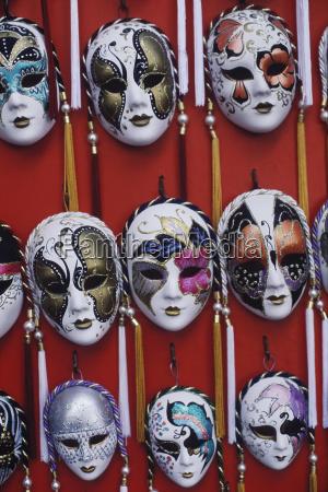 close up of masquerade masks hanging