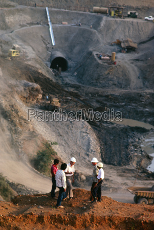 workers on irrigation dam project in