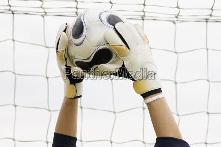 close up of a goalies hands