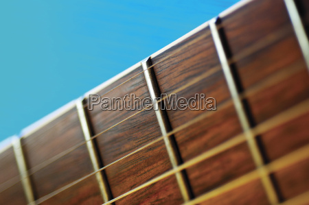 close up of guitar frets and
