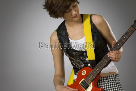 close up of a female guitarist