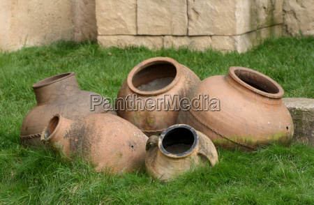 several clay pots on the grass