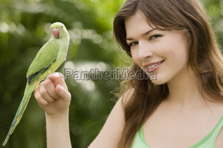 parrot on a young womans hand