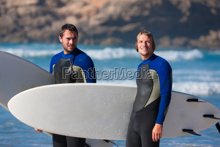 two surfers at the beach
