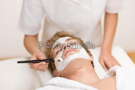 man cosmetics facial mask in