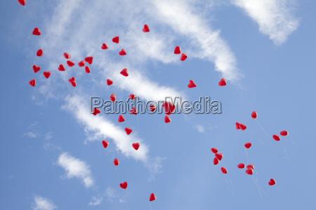 heart balloons on blue sky