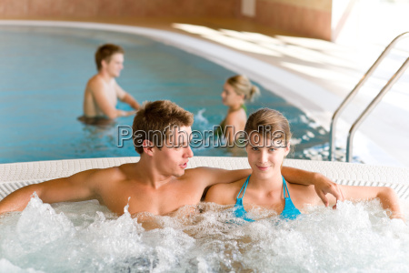 swimming pool young couple relax