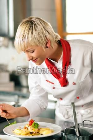 cook cooking in restaurant