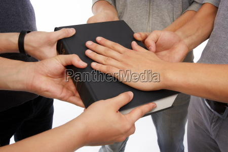holding holy bible and taking promises