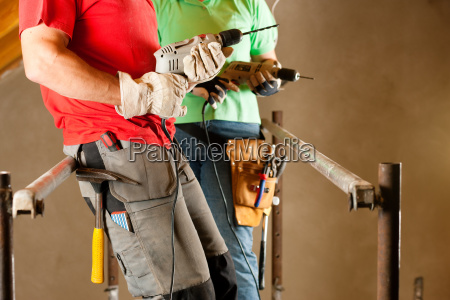 couple in home improvement and expansion