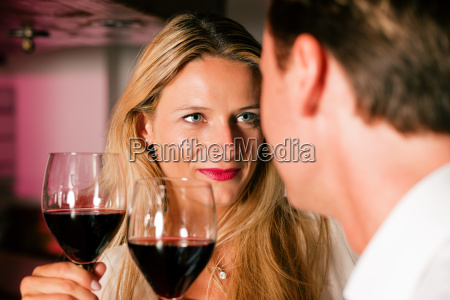 man and woman flirting in hotel