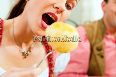 people eat dumplings in restaurant
