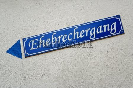 street sign adulterer gang in blue