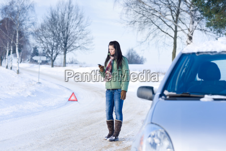 winter car breakdown woman call