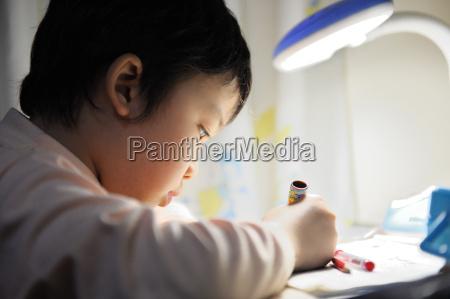 asian kid learning