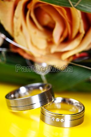 wedding rings on yellow