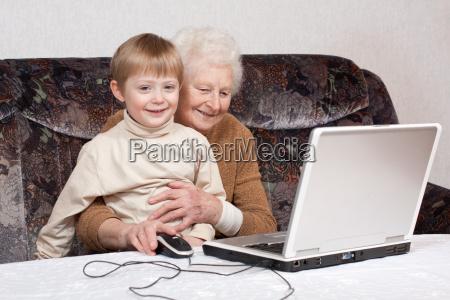 grandma with grandchildren and laptop