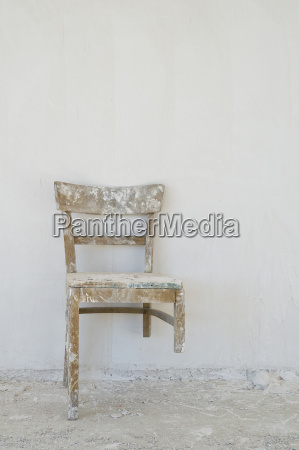 old damaged chair on a construction