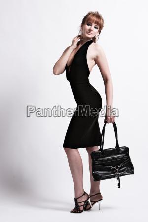woman in evening dress with handbag