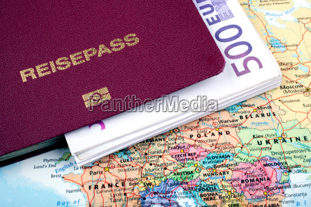 passport with banknotes on travel map
