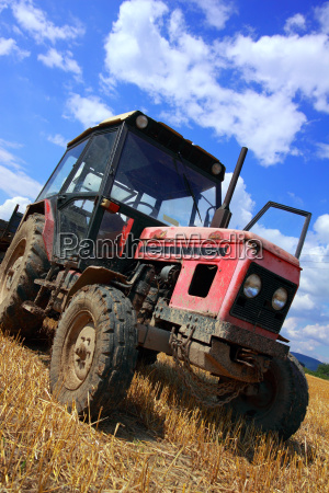 red old tractor in summer on
