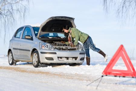 winter car breakdown woman repair