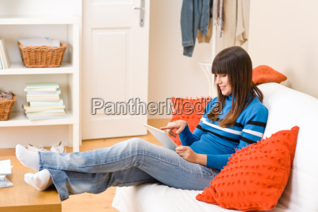 teenager girl relax home with touch