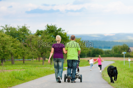 family with children on walk