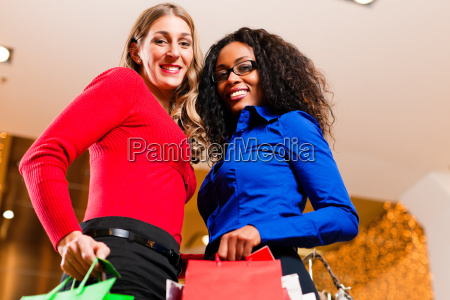 two women shopping in a department