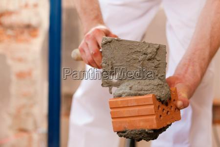 maurer works on construction site