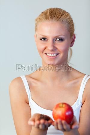 beautiful woman holding chocolate and apple