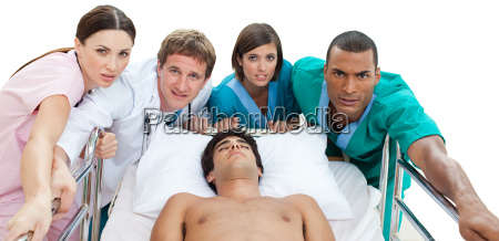 medical team carrying a patient to