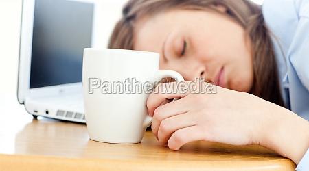 slumbery woman sleeping on table in