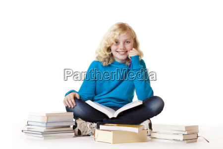 schoolgirl learns from books