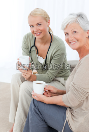 doctor drinking with her patient