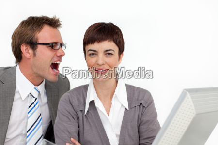 young businessman shouting into his colleagues