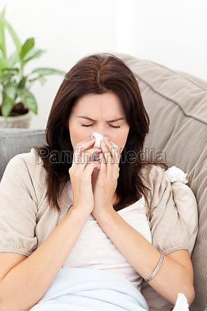 portrait of a sick woman blowing