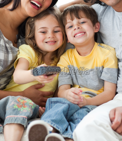 adorable children watching tv with their