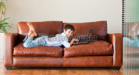 young kid with a laptop on